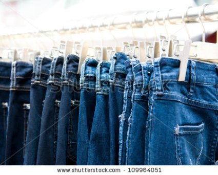 stock-photo-row-of-hanged-blue-jeans-in-a-shop-109964051