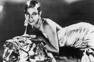 circa 1925: Portrait of American-born singer and dancer Josephine Baker (1906 - 1975) lying on a tiger rug in a silk evening gown and diamond earrings. (Photo by Hulton Archive/Getty Images)