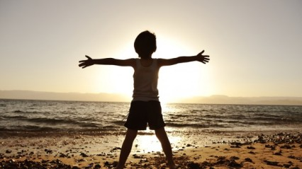 bigstock-silhouette-of-child-on-the-bea-17467202-595x335
